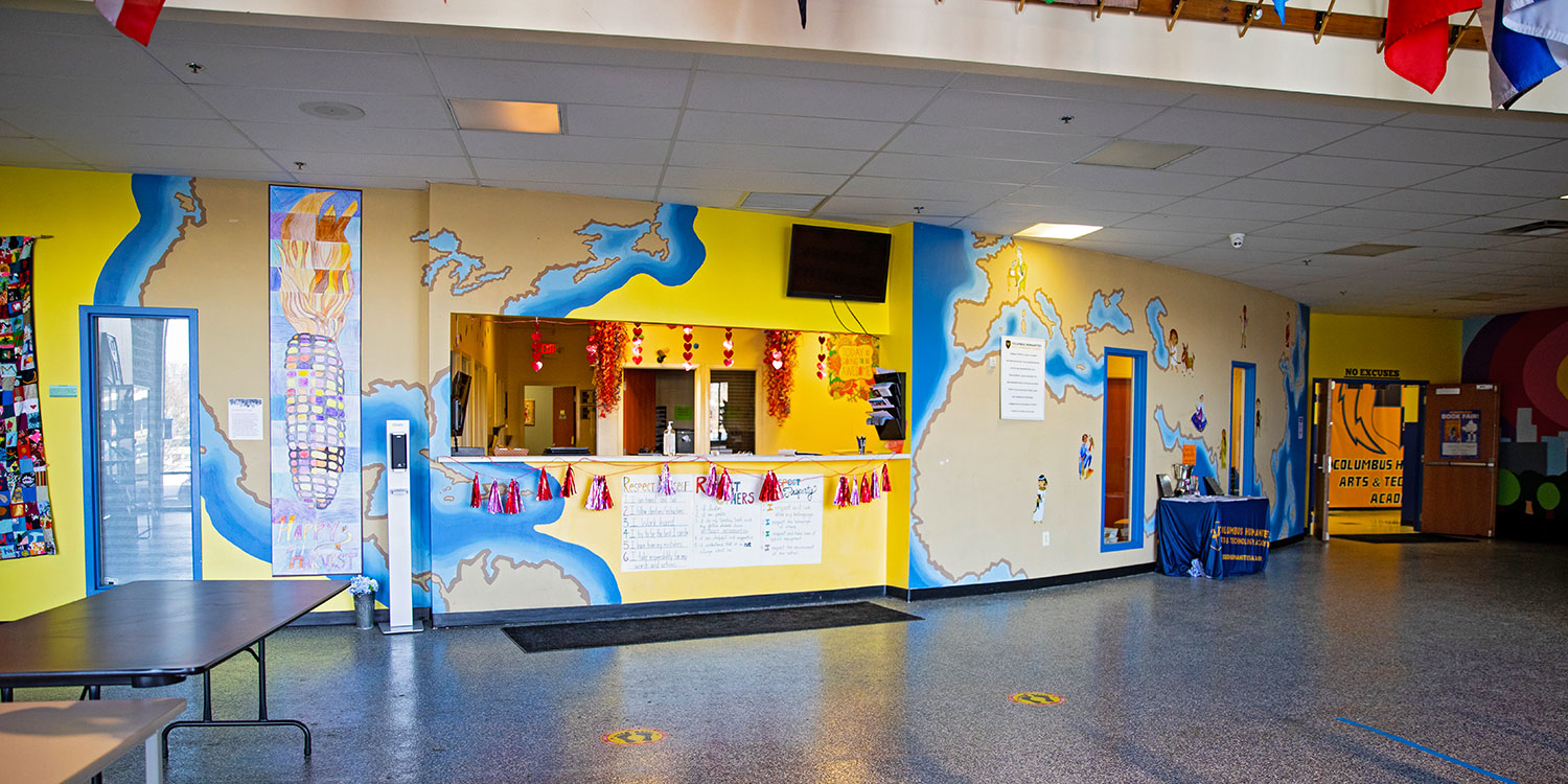 Bright entryway with murals at CHATA.